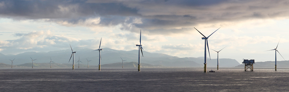 © Rob Arnold.  04/04/2014. North Wales, UK. An evening panoramic of the Gwynt y Môr Offshore Wind Farm off the coast of North Wales. Snowdonia National Park can be seen in the distance. Photo credit : Rob Arnold