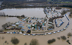 DATE CORRECT AS CAPTIONED   © Licensed to London News Pictures. 22/12/2019. Yalding, UK. Boats are moored on the river Medway  as flood water has inundated the Little Venice caravan park near Yalding in Kent after the River Medway burst its banks. River levels remain high after a second night of heavy rain in the south. More rain is expected today. Photo credit: Peter Macdiarmid/LNP