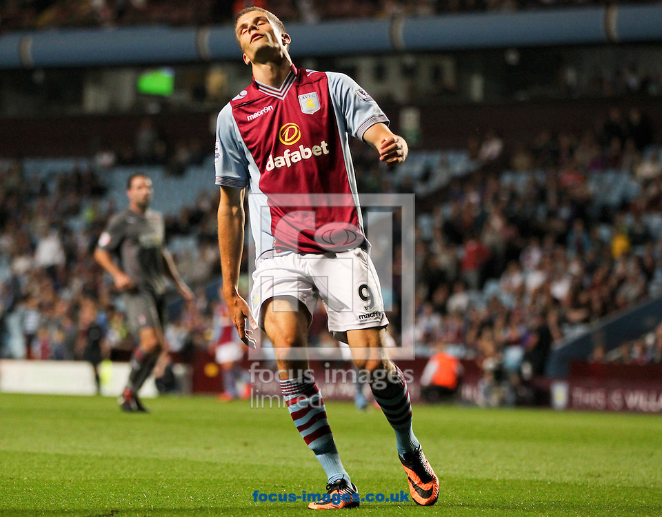 Picture by Tom Smith/Focus Images Ltd 07545141164<br /> 28/08/2013<br /> Nicklas Helenius of Aston Villa reacts to missing a chance during the Capital One Cup match at Villa Park, Birmingham.