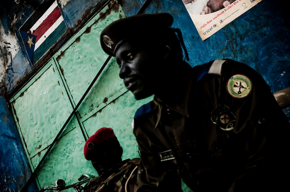 Two soldiers with the SPLA watch over the streets in the Southern Sudanese town of Aweil. Sudan recently voted on whether or not to remain with the North or to set out alone as the world's newest nation. (© William B. Plowman)