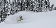 Tim Hoff glides his Ski doo through over the head powder in Wyomings Gros Ventre range in 2012