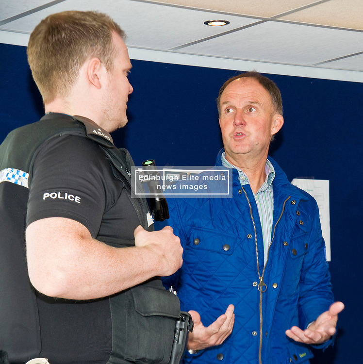 Pictured: PC Brian McGuff, Community officer, chats with Sandy Allan ROSPA<br /> <br /> Destination Drive launch. The initiative aims to help older drivers stay safe on the road. Open invitation to first drop-in session where you can get a free assessment drive and try the current theory and hazard perception tests. <br /> <br /> Ger Harley | EEm 12 June 2018
