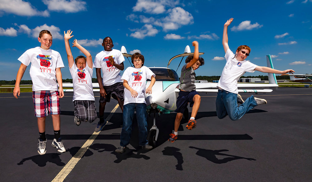Young boys during the EAA 690 summer camp having fun on the ramp at Lawreneville's Briscoe Field.  Created by aviation photographer John Slemp of Aerographs Aviation Photography. Clients include Goodyear Aviation Tires, Phillips 66 Aviation Fuels, Smithsonian Air & Space magazine, and The Lindbergh Foundation.  Specialising in high end commercial aviation photography and the supply of aviation stock photography for commercial and marketing use.