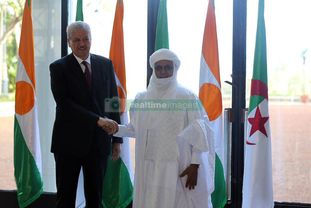 Algerian PM Abdelmalek Sellal shakes hands with his Nigerien counterpart Brig Rafini at the Government palace in Algiers, Algeria, October 27, 2016. Photo by Billal Bensalem/APP/ABACARESS.COM