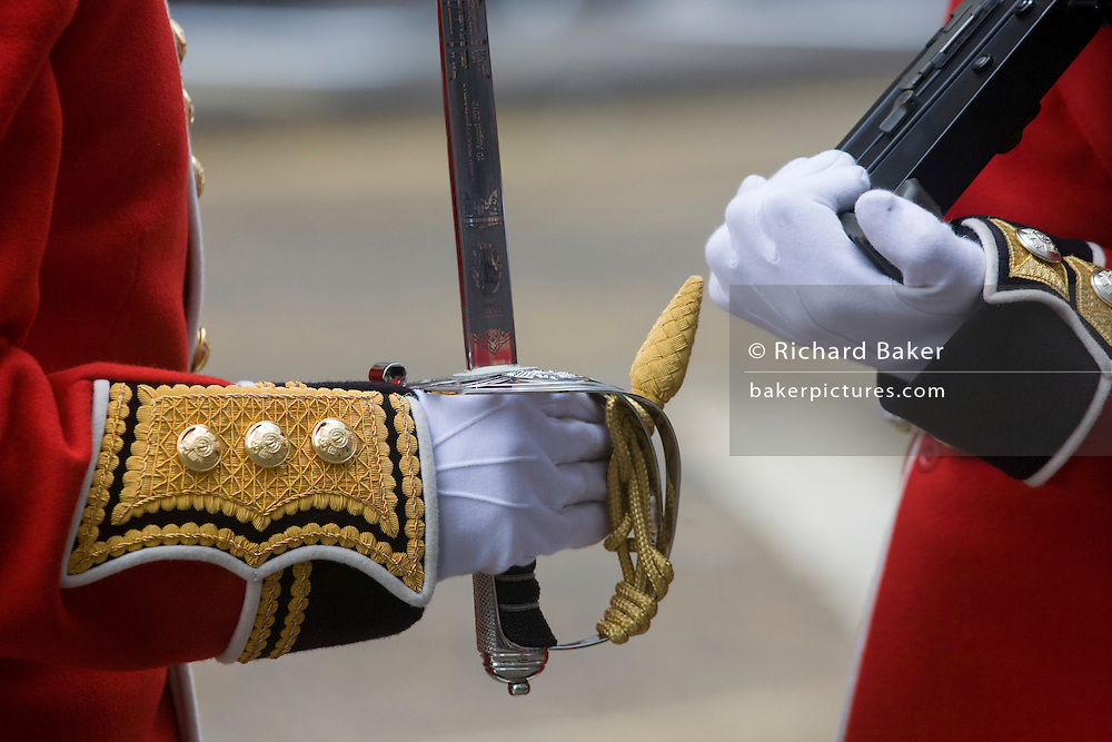 Detail of senior officers gloved hands before the funeral of Margaret Thatcher. Draped in the union flag and mounted on a gun carriage, the coffin of ex-British Prime Minister Baroness Margaret Thatcher's coffin travels along Fleet Street towards St Paul's Cathedral in London, England. Afforded a ceremonial funeral with military honours, not seen since the death of Winston Churchill in 1965, family and 2,000 VIP guests (incl Queen Elizabeth) await her cortege. Margaret Hilda Thatcher, Baroness Thatcher (1925- 2013) was a British politician who was thePrime Minister of the United Kingdomfrom 1979 to 1990 and theLeader of the Conservative Partyfrom 1975 to 1990, the longest-serving British Prime Minister of the 20th century and the only woman to have held the office to date.