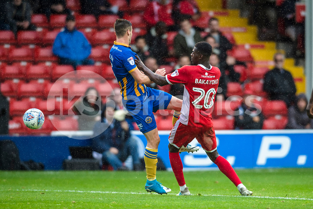 Amadou Bakayoko of Walsall gets the ball past Mat Sadler of Shrewsbury Town during the EFL Sky Bet League 1 match between Walsall and Shrewsbury Town at the Banks's Stadium, Walsall, England on 7 October 2017. Photo by Darren Musgrove.