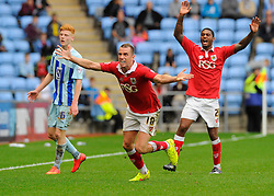 Bristol City's Aaron Wilbraham and Bristol City's Mark Little appeal for a throw in  - Photo mandatory by-line: Joe Meredith/JMP - Mobile: 07966 386802 - 18/10/2014 - SPORT - Football - Coventry - Ricoh Arena - Bristol City v Coventry City - Sky Bet League One