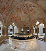 Fountain for ablutions in an octagonal cross vaulted pavilion, built 12th century, in the cloister, in the Royal Abbey of Santa Maria de Poblet, a Cistercian monastery founded in 1151, built by Arnau Bargues in Catalan Gothic style, in Conca de Barbera, Tarragona, Catalonia, Spain. Poblet formed part of the Cistercian Triangle in Catalonia, along with Vallbona de les Monges and Santes Creus, and was the royal burial place of the Aragon dynasty. The monastery is listed as a UNESCO World Heritage Site. Picture by Manuel Cohen