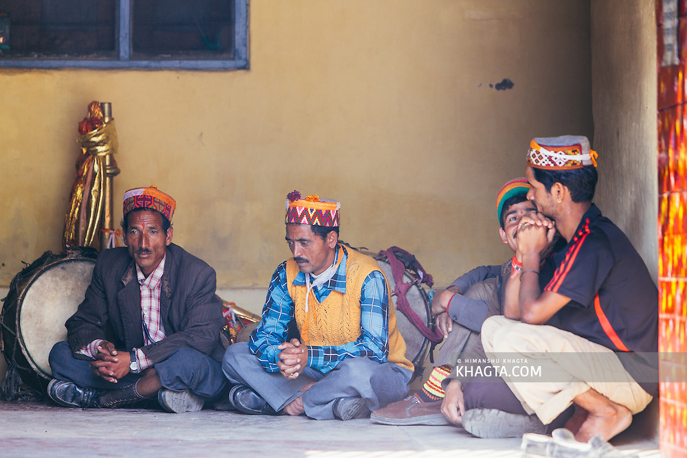 Musicians waiting outside the Raghunath temple as the deity goes inside to takes blessings. Lower caste are still not allowed inside many temples in the Himalayas.