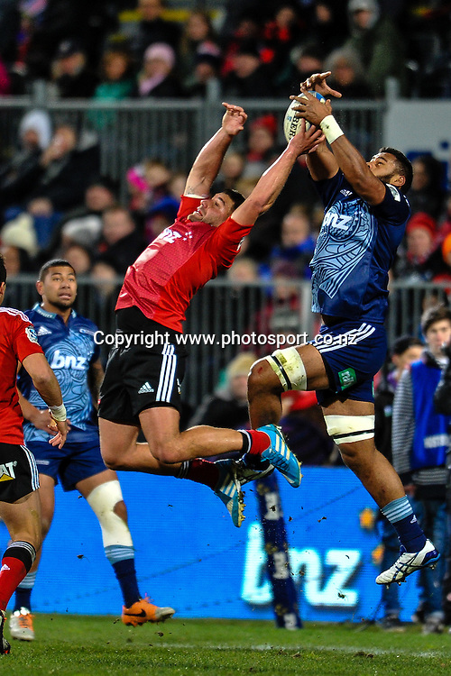 Patrick Tuipulotu of the Blues and Kieron Fonotia of the Crusaders fight for a high kick in the Super 15 match,  Crusaders v The Blues, at AMI Stadium, Christchurch, on the 5 July 2014 . Photo:John Davidson/www.photosport.co.nz
