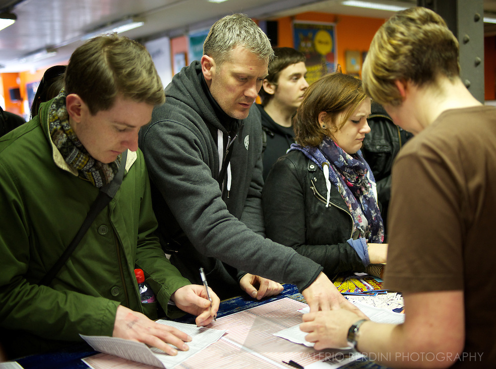 Fans pick their favourite special release for Record Store Day 2013. Piccadilly Records store in Manchester UK.
