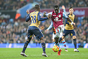 Aston Villa's Idrissa Gueye attempts to clear the ball during the Barclays Premier League match between Aston Villa and Arsenal at Villa Park, Birmingham, England on 13 December 2015. Photo by Shane Healey.