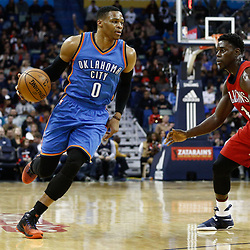 Dec 21, 2016; New Orleans, LA, USA;  Oklahoma City Thunder guard Russell Westbrook (0) is defended by New Orleans Pelicans guard Jrue Holiday (11) during the first quarter of a game at the Smoothie King Center. Mandatory Credit: Derick E. Hingle-USA TODAY Sports