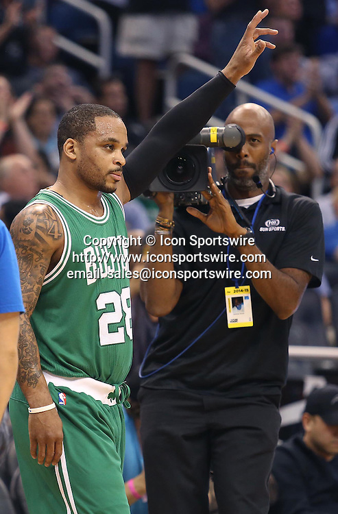 Dec. 23, 2014 - Orlando, FL, USA - The Boston Celtics' Jameer Nelson acknowledges the crowd after a tribute video was played amid a game against at Orlando Magic, Nelson's former team, at the Amway Center in Orlando, Fla., on Tuesday, Dec. 23, 2014
