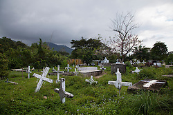 A view of a cemetery on January 23, 2013  in Sambo Creek, Honduras. Before medicines were made widely available in the early 2000s scores of people in the Garifuna community passed away from AIDS.  According to local NGOs, the death rate has dropped dramatically. (David Rochkind/ Pulitzer Center)