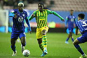 Wigan Athletic defender Cedric Kipre (21) and West Bromwich Albion defender Nathan Ferguson (36) during the EFL Sky Bet Championship match between Wigan Athletic and West Bromwich Albion at the DW Stadium, Wigan, England on 11 December 2019.