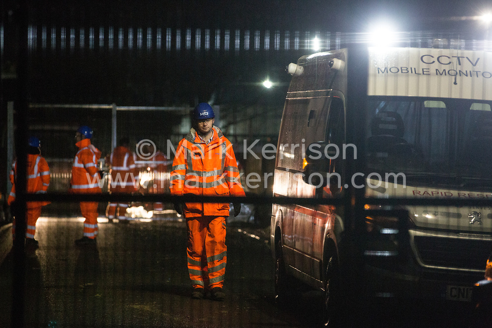 Harefield, UK. 8 February, 2020. HS2 engineers and a CCTV vehicle monitor one of two roadblocks implemented in Harvil Road in the Colne Valley in the early hours of the morning in order to permit tree felling works for the high-speed rail project. The Chiltern Rail line was also closed for the works.