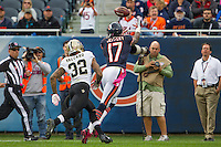 06 October 2013: Wide receiver (17) Alshon Jeffery of the Chicago Bears catches a pass while being guarded by (32) Kenny Vaccaro of the New Orleans Saints during the second half of the Saints 26-18 victory over the Bears in an NFL Game at Soldier Field in Chicago, IL.