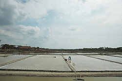 July 4, 2018 - Rembang, Java, Indonesia - Farmers collect salt at one of the industrial salt centers in Mojowarno Village, Rembang, Central Java, July 5, 2018. The low productivity of the plant and salt farmers in Indonesia reaches 4.2 million tons every year, dominated by industrial salt, through Garam Corporation extending the 40 thousand hectare salt fields in eastern Indonesia projected to meet the needs of self-sufficiency in industrial salt , and exports. (Credit Image: © Dasril Roszandi/NurPhoto via ZUMA Press)