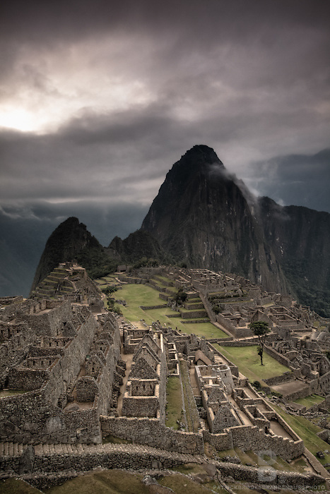 "A dramatic landscape of the famous vantage point of Machu Picchu, one of the wonders of the world and the icon of the Incan Empire. Machu Picchu is a pre-Columbian 15th-century Inca site located 2,430 metres (7,970 ft). Most archaeologists believe that Machu Picchu was built as an estate for the Inca emperor Pachacuti (1438-1472). Often referred to as the ""Lost City of the Incas."" Wayna Picchu is the peak that sits in  the background as also has ruins on it."