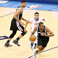 06 May 2016: San Antonio Spurs forward Kawhi Leonard (2) drives past Oklahoma City Thunder guard Andre Roberson (21) on a screen set by San Antonio Spurs center Tim Duncan (21) during the San Antonio Spurs 100-96 victory over the Oklahoma City Thunder, during Game Three of the Western Conference Semifinals of the NBA Playoffs at the Chesapeake Energy Arena, Oklahoma City, Oklahoma, USA.