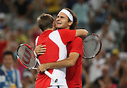 Roger Federer (L)and Stanislas Wawrinka of Switzerland embrace as they won in the Men's Doubles Tennis Finals at the Olympics in Beijing, China, Saturday Aug. 8 2008. The Beijing Olympics will run until August 24. Photographer/Natalie Behring