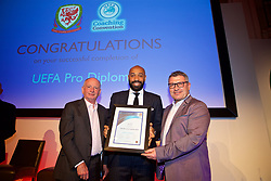 NEWPORT, WALES - Friday, May 18, 2018: Thierry Henry receives his UEFA Pro Licence Diploma from Lennie Lawrence (left) and Wales technical director Osian Roberts (right) during day one of the Football Association of Wales' National Coaches Conference 2018 at the Celtic Manor Resort. (Pic by David Rawcliffe/Propaganda)