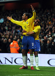 Robinho celebrates scoring the second goal for Brazil with team mate Marcelo during the International Friendly match between Brazil and Italy at the Emirates Stadium on February 10, 2009 in London, England.