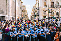 "PALERMO, ITALY - 16 JUNE 2018: A marching band plays for Marinella Senatore's performance ""Palermo Procession"" at Manifesta 12, the European nomadic art biennal, in Palermo, Italy, on June 16th 2018.<br /> <br /> Manifesta is the European Nomadic Biennial, held in a different host city every two years. It is a major international art event, attracting visitors from all over the world. Manifesta was founded in Amsterdam in the early 1990s as a European biennial of contemporary art striving to enhance artistic and cultural exchanges after the end of Cold War. In the next decade, Manifesta will focus on evolving from an art exhibition into an interdisciplinary platform for social change, introducing holistic urban research and legacy-oriented programming as the core of its model.<br /> Manifesta is still run by its original founder, Dutch historian Hedwig Fijen, and managed by a permanent team of international specialists.<br /> <br /> The City of Palermo was important for Manifesta's selection board for its representation of two important themes that identify contemporary Europe: migration and climate change and how these issues impact our cities."