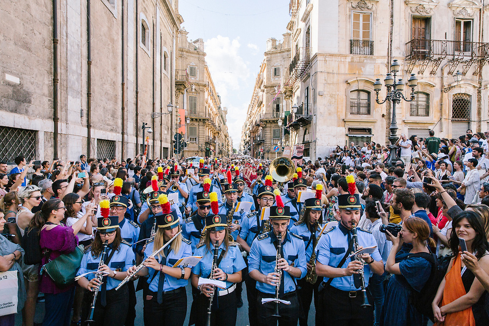 PALERMO, ITALY - 16 JUNE 2018: A marching band plays for Marinella Senatore's performance &quot;Palermo Procession&quot; at Manifesta 12, the European nomadic art biennal, in Palermo, Italy, on June 16th 2018.<br /> <br /> Manifesta is the European Nomadic Biennial, held in a different host city every two years. It is a major international art event, attracting visitors from all over the world. Manifesta was founded in Amsterdam in the early 1990s as a European biennial of contemporary art striving to enhance artistic and cultural exchanges after the end of Cold War. In the next decade, Manifesta will focus on evolving from an art exhibition into an interdisciplinary platform for social change, introducing holistic urban research and legacy-oriented programming as the core of its model.<br /> Manifesta is still run by its original founder, Dutch historian Hedwig Fijen, and managed by a permanent team of international specialists.<br /> <br /> The City of Palermo was important for Manifesta&rsquo;s selection board for its representation of two important themes that identify contemporary Europe: migration and climate change and how these issues impact our cities.