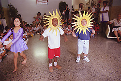 Nursery school children taking part in school play wearing costumes,