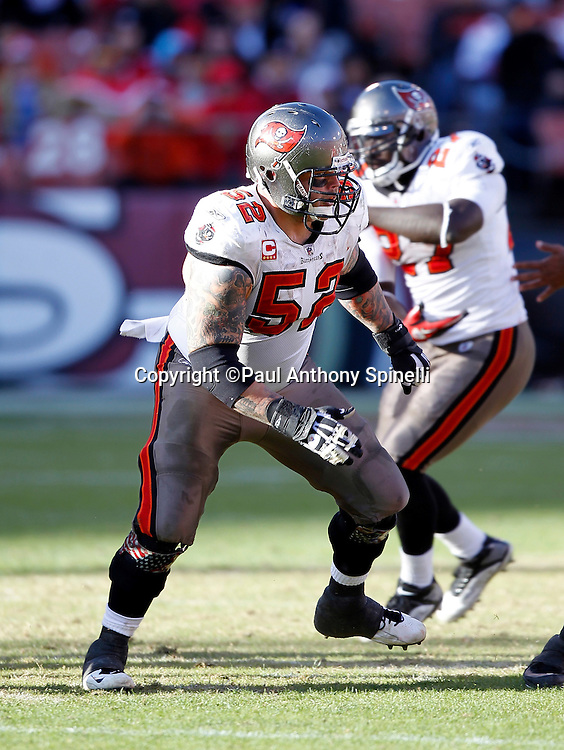 Tampa Bay Buccaneers center Jeff Faine (52) run blocks during the NFL week 11 football game against the San Francisco 49ers on Sunday, November 21, 2010 in San Francisco, California. The Bucs won the game 21-0. (©Paul Anthony Spinelli)
