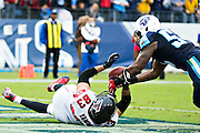 NASHVILLE, TN - OCTOBER 25:  Avery Williamson #54 of the Tennessee Titans makes a interception in the end zone with a pass thrown to Jacob Tamme #83 of the Atlanta Falcons at Nissan Stadium on October 25, 2015 in Nashville, Tennessee.  The Falcons defeated the Titans 10-7.  (Photo by Wesley Hitt/Getty Images) *** Local Caption *** Avery Williamson; Jacob Tamme