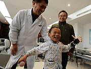 WUHAN, CHINA - NOVEMBER 16: (CHINA OUT) <br /> <br /> 3D-Printed Hand Completed<br /> <br /> A child wears 3D-printed hand at Wuhan Third Hospital on November 16, 2015 in Wuhan, Hubei Province of China. A child, a farmer Liu Tao\'s son, fell into a fiery pit where straws was burning when he was only three years old. Left ear and left hand got injured heavily that the left hand had to be cut. While a phone in May this year from Wuhan Third Hospital gave them hope that the lost left hand could be replaced by 3D-printed hand and luckily it made success on the child finally. <br /> ©Exclusivepix Media