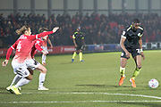 Macclesfield Town midfielder Emmanuel Osadebe has a shot at goal during the EFL Sky Bet League 2 match between Salford City and Macclesfield Town at the Peninsula Stadium, Salford, United Kingdom on 23 November 2019.