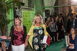 June 19, 2017 - Naples, Campania, Italy - A worldly long-awaited event in the city also for the prestigious location that hosts it, Palazzo Caracciolo MGallery by Sofitel, located in the heart of Naples, in via Carbonara. The beautiful 16th century cloister of the hotel for one evening is dyed with green with lights and special effects, on the catwalk for haute couture the new collections signed Gai Mattiolo, Plein sud, Just Cavalli, Maria Grazia Severi and Ermanno Scervino proposed by Noemi Boutique. While accessories have been a great success, the new collection of Tom Bags, inspired by the world of tattoos, with its strong colours and gritty style. Much admire the models in a look from the tropical mood thanks to the creativity of team Leo for the hairstyles and staff of Liliana Padua for make up. During the event, conducted by the journalist Serena Albano, there was no lack of surprises for the audience present in the hall with the live performances of Luigi Tufano to the violin and Lello Palma to the sax who accompanied in a highly suggestive atmosphere the steps of the models. A very ''fragrant'' evening with the announced olfactory path dedicated to the fragrances ''theatre'' curated by ''Perfume'', the Neapolitan boutique renowned for the refined and exclusive scents proposed. The parade was preceded by a cocktail party with the tasting of a gourmet dish, inspired by the event, by Daniele Riccardi, resident chef of Palazzo Caracciolo, the delicacies of the Capriccio confectionery and the agricultural company, all a (Credit Image: © Sonia Brandolone/Pacific Press via ZUMA Wire)
