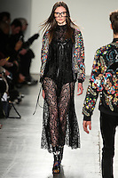 Adela Novotna walks the runway wearing Custo Barcelona Fall 2016 20th Anniversary Collection during New York Fashion Week on February 14, 2016