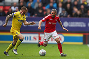 Barry Fuller (captain) of AFC Wimbledon and Ricky Holmes of Charlton Athletic battle to win the ball during the EFL Sky Bet League 1 match between Charlton Athletic and AFC Wimbledon at The Valley, London, England on 28 October 2017. Photo by Toyin Oshodi.