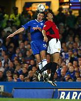 Photograph: Scott Heavey.<br />Chelsea v Manchester United. FA Barclaycard Premiership. 30/11/2003.<br />John Terry out-jumps Rio Ferdinand