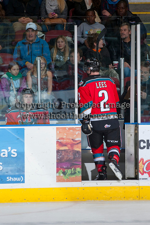 KELOWNA, CANADA - DECEMBER 6: Jesse Lees #2 of the Kelowna Rockets heads to the penalty box against the Everett Silvertips on December 6, 2013 at Prospera Place in Kelowna, British Columbia, Canada.   (Photo by Marissa Baecker/Shoot the Breeze)  ***  Local Caption  ***
