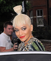 Singer Rita Ora attends the House of Holland catwalk show during London Fashion Week Spring Summer 2015 in London, UK. 13/09/2014 <br />BYLINE MUST READ : GOTCHAIMAGES.COM<br /><br />Copyright by © Gotcha Images Ltd. All rights reserved.<br />Usage of this image is conditional upon the acceptance <br />of Gotcha Images Ltd, terms and conditions available at<br />www.gotchaimages.com