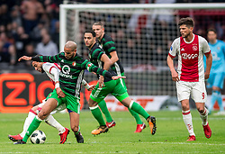 21-01-2018 NED: AFC Ajax - Feyenoord, Amsterdam<br /> Ajax was met 2-0 te sterk voor Feyenoord / Duel tussen WK gangers Hakim Ziyech #10 of AFC Ajax en Karim El Ahmadi #8 of Feyenoord
