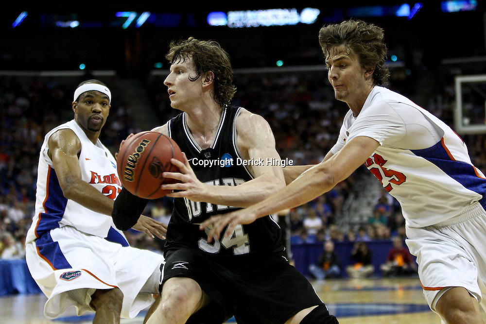 Mar 26, 2011; New Orleans, LA; Butler Bulldogs forward Matt Howard (54) is guarded by Florida Gators forward Chandler Parsons (25) during the second half of the semifinals of the southeast regional of the 2011 NCAA men's basketball tournament at New Orleans Arena.   Mandatory Credit: Derick E. Hingle