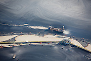Skimming operations on tailing pond at oil sands mine
