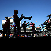 NEW YORK, NEW YORK - APRIL 27:  Cincinnati Reds players warming up before the New York Mets Vs Cincinnati Reds MLB regular season game at Citi Field on April 27, 2016 in New York City. (Photo by Tim Clayton/Corbis via Getty Images)