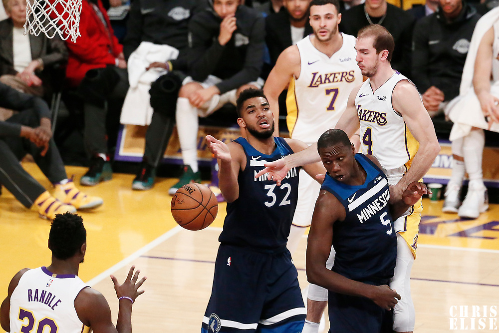 25 December 2017: Los Angeles Lakers guard Alex Caruso (4) passes the ball past Minnesota Timberwolves center Gorgui Dieng (5) and Minnesota Timberwolves center Karl-Anthony Towns (32) to Los Angeles Lakers forward Julius Randle (30) during the Minnesota Timberwolves 121-104 victory over the LA Lakers, at the Staples Center, Los Angeles, California, USA.