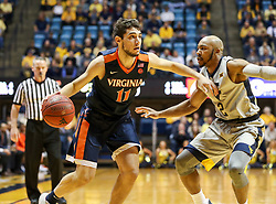 Dec 5, 2017; Morgantown, WV, USA; Virginia Cavaliers guard Ty Jerome (11) drives past West Virginia Mountaineers guard Jevon Carter (2) during the first half at WVU Coliseum. Mandatory Credit: Ben Queen-USA TODAY Sports