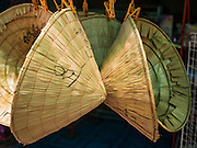 18 JUNE 2016 - DON KHONE, CHAMPASAK, LAOS:  Typical Lao style conical hats for sale in Don Khone. Don Khone Island, one of the larger islands in the 4,000 Islands chain on the Mekong River in southern Laos. The island has become a backpacker hot spot, there are lots of guest houses and small restaurants on the north end of the island.    PHOTO BY JACK KURTZ