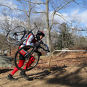 A competitor carries his bike up a steep hill during the Cyclo-Cross, Supercross Cup 2013 UCI Weekend at the Anthony Wayne Recreation Area, Stony Point, New York. USA. 24th November 2013. Photo Tim Clayton