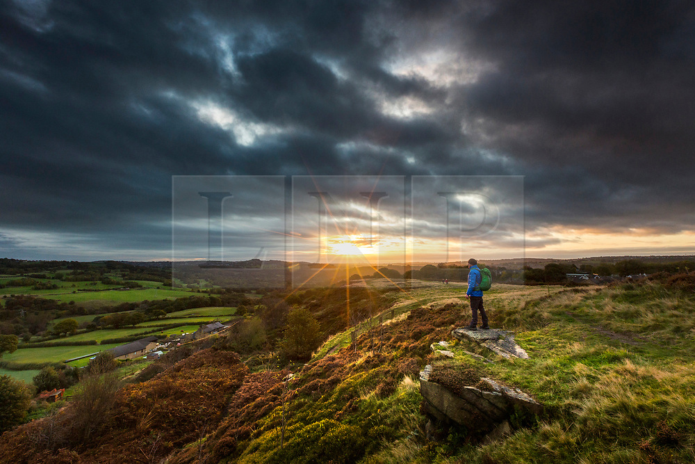 © Licensed to London News Pictures. 20/10/2019. Baildon UK. Dark clouds roll over Baildon Moor in Yorkshire at sunrise this morning as the UK expects more bad weather. Photo credit: Andrew McCaren/LNP